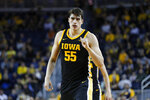 Iowa center Luka Garza reacts to a basket against Michigan in the second half of an NCAA college basketball game in Ann Arbor, Mich., Friday, Dec. 6, 2019. (AP Photo/Paul Sancya)
