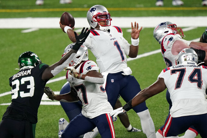 New England Patriots quarterback Cam Newton, center, throws during the first half of an NFL football game against the New York Jets, Monday, Nov. 9, 2020, in East Rutherford, N.J. (AP Photo/Corey Sipkin)