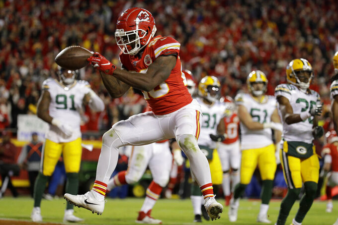 Kansas City Chiefs running back Damien Williams (26) celebrates a touchdown during the second half of an NFL football game against the Green Bay Packers in Kansas City, Mo., Sunday, Oct. 27, 2019. (AP Photo/Charlie Riedel)