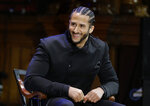 FILE - In this Oct. 11, 2018, file photo, former NFL football quarterback Colin Kaepernick smikes on stage during W.E.B. Du Bois Medal ceremonies at Harvard University, in Cambridge, Mass. Colin Kaepernick and Eric Reid have reached settlements on their collusion lawsuits against the NFL, the league said Friday, Feb. 19, 2019. (AP Photo/Steven Senne, File)