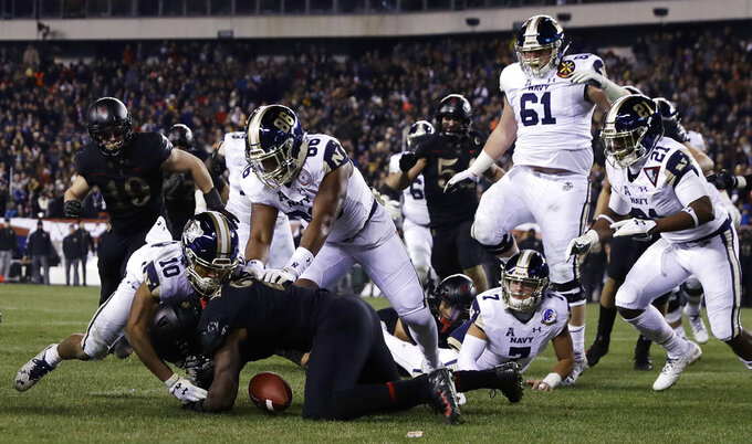 Army's James Gibson (2) recovers a fumble against Navy's Malcolm Perry (10) and OJ Davis (86) during the second half of an NCAA college football game, Saturday, Dec. 8, 2018, in Philadelphia. Army won 17-10. (AP Photo/Matt Slocum)