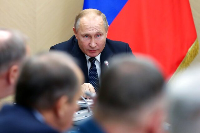 Russian President Vladimir Putin chairs a Security Council meeting at the Novo-Ogaryovo residence outside Moscow, Russia, Friday, Nov. 22, 2019. (Yekaterina Shtukina, Sputnik, Government Pool Photo via AP)