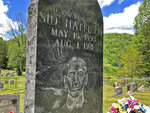 In this Tuesday, May 12, 2020, photo is the gravestone of Sid Hatfield, in Buskirk, Ky. Hatfield was the police chief in nearby Matewan, W.Va He was involved in a gunfight between miners and detectives hired by a coal company. Hatfield survived the May 19, 1920, gunfight that left 10 people dead but he was fatally shot a year later. (AP Photo/John Raby)