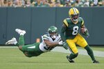 Green Bay Packers' Amari Rodgers gets past New York Jets' Isaiah Dunn during the first half of a preseason NFL football game Saturday, Aug. 21, 2021, in Green Bay, Wis. (AP Photo/Mike Roemer)