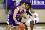 Northwestern State guard Jovan Zelenbaba (15) handles the ball as TCU guard PJ Fuller (4) defends during the second half of an NCAA college basketball game in Fort Worth, Texas, Thursday, Dec. 3, 2020. (AP Photo/Tony Gutierrez)