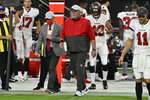 Tampa Bay Buccaneers head coach Bruce Arians walks onto the field after defeating the Las Vegas Raiders in an NFL football game, Sunday, Oct. 25, 2020, in Las Vegas. (AP Photo/David Becker)