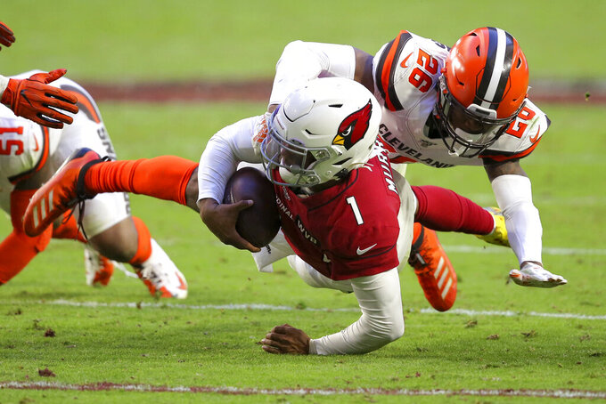 Arizona Cardinals quarterback Kyler Murray (1) gains the first down as he is tackled by Cleveland Browns cornerback Greedy Williams (26) during the second half of an NFL football game, Sunday, Dec. 15, 2019, in Glendale, Ariz. (AP Photo/Ross D. Franklin)