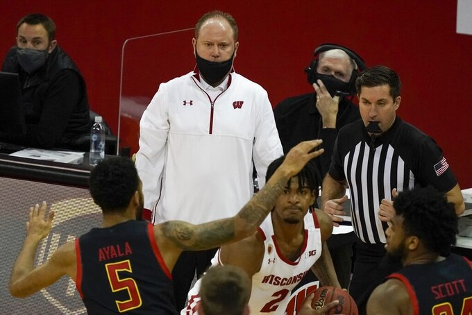 Wisconsin head coach Greg Gard watches during the second half of an NCAA college basketball game against Maryland Monday, Dec. 28, 2020, in Madison, Wis. (AP Photo/Morry Gash)
