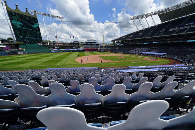 Cutouts of fans fill empty seats in Kauffman Stadium during the fourth inning of a baseball game between the Kansas City Royals and the Chicago White Sox Sunday, Aug. 2, 2020, in Kansas City, Mo. (AP Photo/Charlie Riedel)