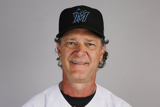 FILE - In this 2020 file photo, Miami Marlins manager Don Mattingly poses for a photo. Mattingly won the NL Manager of the Year award on Tuesday night. Mattingly guided the Marlins to their first playoff appearance since 2003 despite dealing with a COVID-19 outbreak that paused their season and ravaged the roster. (AP Photo/Brynn Anderson, File)