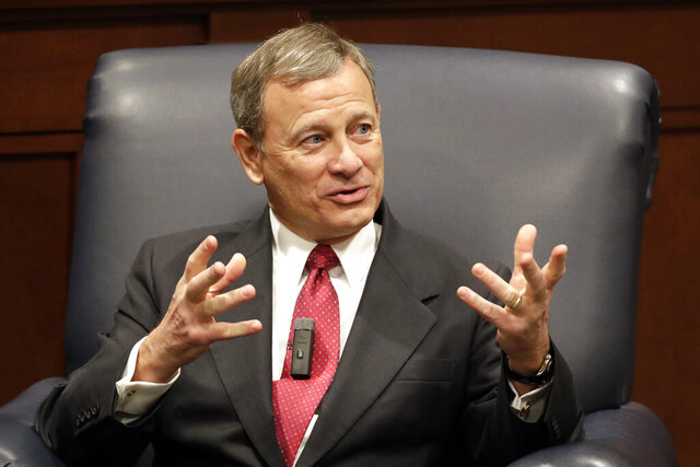 """FILE - In this Feb. 6, 2019 file photo, Supreme Court Chief Justice John Roberts answers questions during an appearance at Belmont University in Nashville, Tenn.  """"OK, Boomer"""