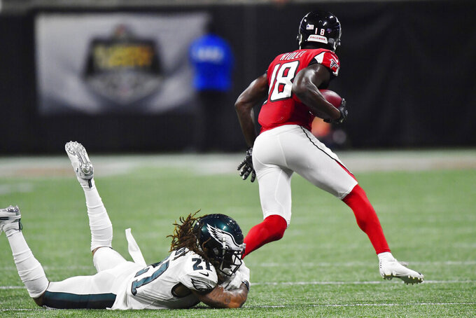 Atlanta Falcons wide receiver Calvin Ridley (18) runs past Philadelphia Eagles cornerback Ronald Darby (21) during the first half of an NFL football game, Sunday, Sept. 15, 2019, in Atlanta. (AP Photo/Mike Stewart)
