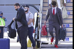 Kansas City Chiefs quarterback Patrick Mahomes, right, arrives with his teammates for the NFL Super Bowl 55 football game against the Tampa Bay Buccaneers, Saturday, Feb. 6, 2021, in Tampa, Fla. (AP Photo/Charlie Riedel)