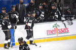Los Angeles Kings left wing Andreas Athanasiou (22) is congratulated for his goal during the third period of the team's NHL hockey game against the Colorado Avalanche on Tuesday, Jan. 19, 2021, in Los Angeles. (AP Photo/Kyusung Gong)