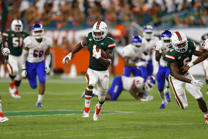 FILE - Miami running back Lorenzo Lingard runs in for a touchdown during the second half an NCAA college football game against Savannah State, Saturday, Sept. 8, 2018, in Miami Gardens, Fla. No. 5 Florida will rely on a number of newcomers, including Lorenzo Lingard, as it tries to dethrone rival Georgia in the Southeastern Conference's East Division. Some of them are freshmen, others are transfers. (AP Photo/Brynn Anderson, File)