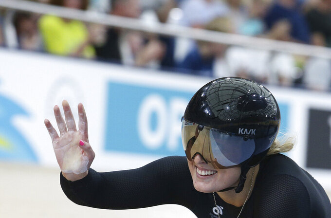 FILE - In this file photo dated Friday, April 6, 2018, New Zealand's Olivia Podmore waves after competing at the Women's Sprint 1/8 finals at the Anna Meares Velodrome during the 2018 Commonwealth Games in Brisbane, Australia. The New Zealand Olympic Committee says track cyclist Olivia Podmore has died suddenly at the age of 24, in a statement released Tuesday Aug. 10, 2021, without disclosing the cause of death. (AP Photo/Tertius Pickard, FILE)