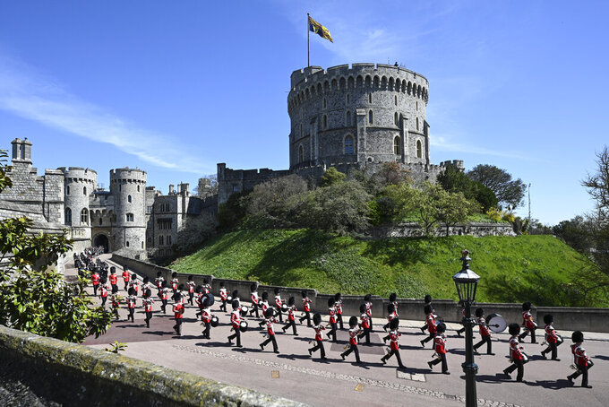 The Grenadier Guards make their way past the Round Tower during the funeral of Britain's Prince Philip inside Windsor Castle in Windsor, England Saturday April 17, 2021. (Leon Neal/Pool via AP)