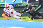 SMU wide receiver Danny Gray, left, scores a touchdown in the first half against Tulane defensive end Cameron Sample, right, during an NCAA college football game in New Orleans, Friday, Oct. 16, 2020. (AP Photo/Matthew Hinton)