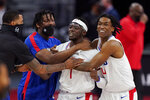 Los Angeles Clippers guard Reggie Jackson (1) is surrounded by teammates after hitting the game winning basket during the second half of an NBA basketball game against the Detroit Pistons, Wednesday, April 14, 2021, in Detroit. (AP Photo/Carlos Osorio)