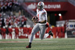 Ohio State quarterback Justin Fields runs with the ball during the first half of an NCAA college football game against Rutgers on Saturday, Nov. 16, 2019, in Piscataway, N.J. (AP Photo/Adam Hunger)