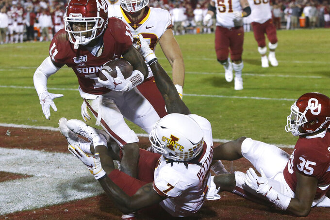 Oklahoma cornerback Parnell Motley (11) intercepts a pass intended for Iowa State wide receiver La'Michael Pettway (7) on a 2-point conversion attempt during the fourth quarter of an NCAA college football game in Norman, Okla., Saturday, Nov. 9, 2019. (AP Photo/Sue Ogrocki)