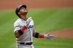 Miami Marlins' Starlin Castro celebrates his home run during the fifth inning of a baseball game against the Washington Nationals, Sunday, Sept. 1, 2019, in Washington. (AP Photo/Nick Wass)