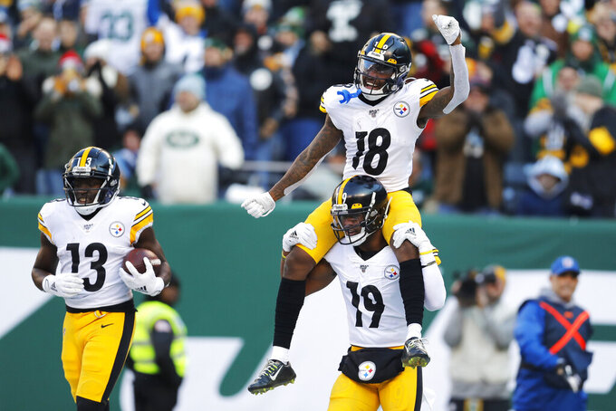 Pittsburgh Steelers wide receiver Diontae Johnson (18) celebrates a touchdown with Pittsburgh Steelers wide receiver JuJu Smith-Schuster (19) in the first half of an NFL football game against the New York Jets, Sunday, Dec. 22, 2019, in East Rutherford, N.J. (AP Photo/Adam Hunger)
