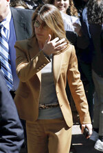 Actress Lori Loughlin arrives at federal court in Boston on Wednesday, April 3, 2019, to face charges in a nationwide college admissions bribery scandal. (AP Photo/Charles Krupa)