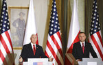 U.S. Vice President Mike Pence gestures next to Polish President Andrzej Duda, right, during press statements after their meeting in Warsaw, Poland, Monday, Sept. 2, 2019. (AP Photo/Petr David Josek)