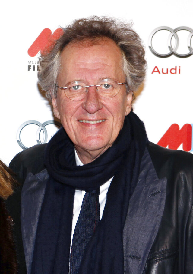 FILE - In this Aug. 2, 2012, file photo, Australian actor Geoffrey Rush arrives for the opening of the Melbourne International Film Festival in Melbourne, Australia. An Australian court on Thursday, July 2, 2020, rejected a newspaper publisher's appeal against Oscar-winning actor Rush's $2.9 billion Australian dollars ($2 million) payout for defamation. (AP Photo/Paul Jeffers, File)