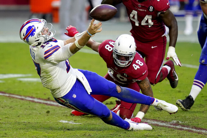 Buffalo Bills quarterback Josh Allen (17) gets the throw off as Arizona Cardinals linebacker Isaiah Simmons (48) defends during the second half of an NFL football game, Sunday, Nov. 15, 2020, in Glendale, Ariz. (AP Photo/Ross D. Franklin)