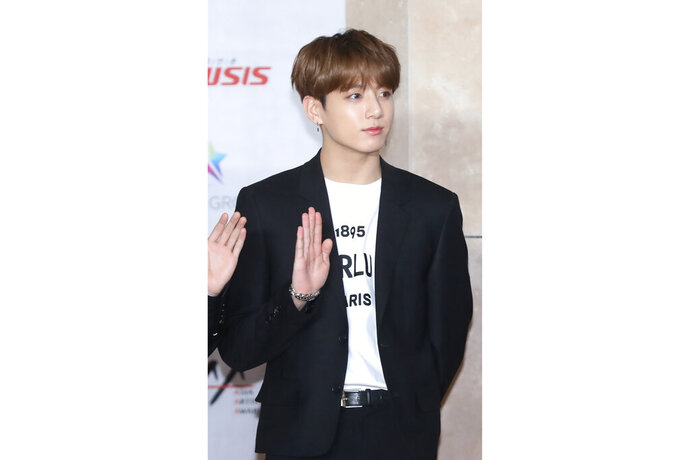 In this Nov. 28, 2018, photo, a member of K-pop group BTS, Jungkook, poses for the media at the Asia Artist Awards in Incheon, South Korea. Police say they are investigating Jungkook over a traffic accident on Saturday, Nov. 2, 2019, involving the band member and a taxi driver. (Cho Su-jeung/Newsis via AP)