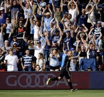 FILE - In this May 26, 2019, file photo, Sporting Kansas City forward Johnny Russell celebrates after scoring a goal during the first half of an MLS soccer match against the Seattle Sounders, in Kansas City, Kan. Many professional sports league, such as the NFL and European soccer leagues, have lucrative television contracts and big-money corporate sponsors that fill their substantial coffers. But the domestic soccer league in the U.S. still relies heavily on ticket sales, merchandising and concessions, much like many university athletic departments, and without games their very ability to make ends meet would stretch the abilities of even the savviest of accountants.(AP Photo/Charlie Riedel, File)