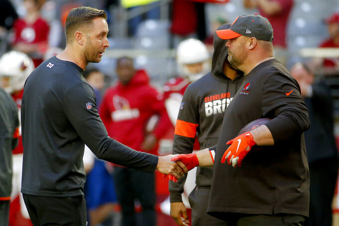 Arizona Cardinals head coach Kliff Kingsbury, left, greets Cleveland Browns head coach Freddie Kitchens prior to an NFL football game, Sunday, Dec. 15, 2019, in Glendale, Ariz. (AP Photo/Rick Scuteri)
