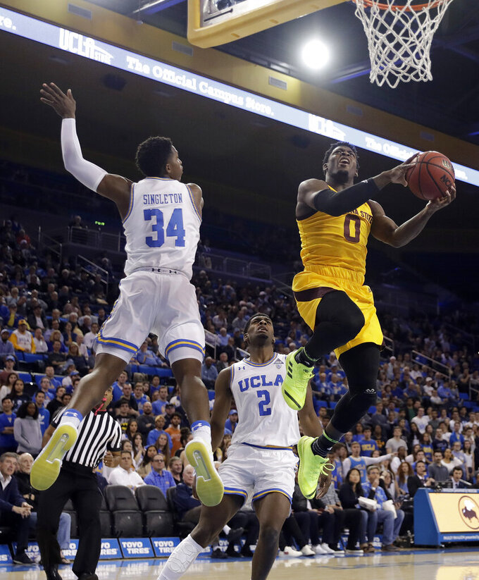 Arizona State guard Luguentz Dort (0) drives past UCLA's David Singleton (34) and Cody Riley (2) during the first half of an NCAA college basketball game Thursday, Jan. 24, 2019, in Los Angeles. (AP Photo/Marcio Jose Sanchez)