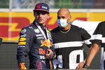 100 meters Olympic Champion Marcell Jacobs poses with second placed Red Bull driver Max Verstappen of the Netherlands after the Sprint qualifying at the Monza racetrack, in Monza, Italy , Saturday, Sept.11, 2021. The Formula one race will be held on Sunday. (AP Photo/Luca Bruno)