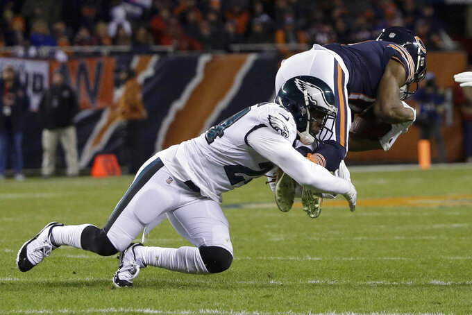 Philadelphia Eagles safety Corey Graham (24) tackles Chicago Bears wide receiver Anthony Miller (17) catches a pass for a first down during the first half of an NFL wild-card playoff football game Sunday, Jan. 6, 2019, in Chicago. (AP Photo/David Banks)