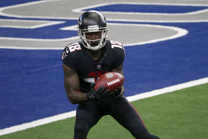 Atlanta Falcons wide receiver Calvin Ridley (18) catches a pass for a touchdown in the first half of an NFL football game against the Dallas Cowboys in Arlington, Texas, Sunday, Sept. 20, 2020. (AP Photo/Michael Ainsworth)