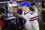 New England Patriots quarterback Tom Brady, left, and Buffalo Bills quarterback Josh Allen speak at midfield after an NFL football game, Saturday, Dec. 21, 2019, in Foxborough, Mass. (AP Photo/Steven Senne)