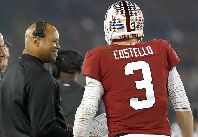Stanford head coach David Shaw, left, talks to quarterback K.J. Costello during a time out against Oregon State in the first half during an NCAA college football game on Saturday, Nov. 10, 2018, in Stanford, Calif. (AP Photo/Tony Avelar)