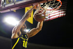 Oregon's Shakur Juiston (10) throws down a dunk against Arizona State during the first half of an NCAA college basketball game Thursday, Feb. 20, 2020, in Tempe, Ariz. (AP Photo/Darryl Webb)