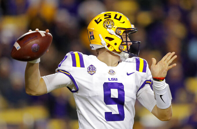 LSU quarterback Joe Burrow (9) passes in the first half of an NCAA college football game against Rice in Baton Rouge, La., Saturday, Nov. 17, 2018. (AP Photo/Gerald Herbert)