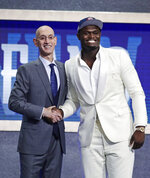 DUke's Zion Williamson, right, poses for photographs with NBA Commissioner Adam Silver after being selected by the New Orleans Pelicans with the first pick in the NBA basketball draft Thursday, June 20, 2019, in New York. (AP Photo/Julio Cortez)