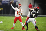 Kansas City Chiefs quarterback Patrick Mahomes (15) throws during the first half of an NFL football game against the Baltimore Ravens, Monday, Sept. 28, 2020, in Baltimore. (AP Photo/Nick Wass)