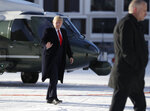US President Donald Trump waves as he arrives in Davos, Switzerland on Marine One, Tuesday, Jan. 21, 2020. President Trump arrived in Switzerland on Tuesday to start a two-day visit to the World Economic Forum. (AP Photo/Evan Vucci)