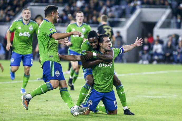 Seattle Sounders midfielder Nicolas Lodeiro, right, celebrates his goal with teammates during the first half of the MLS soccer Western Conference final against Los Angeles FC, Tuesday, Oct. 29, 2019, in Los Angeles. (AP Photo/Ringo H.W. Chiu)