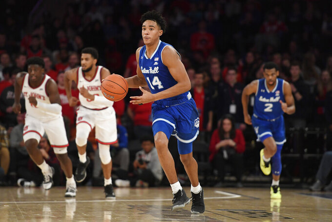 Seton Hall guard Jared Rhoden (14) dribbles the ball upcourt during the first half of an NCAA college basketball game against St. John's in New York, Saturday, Jan. 18, 2020. (AP Photo/Sarah Stier)
