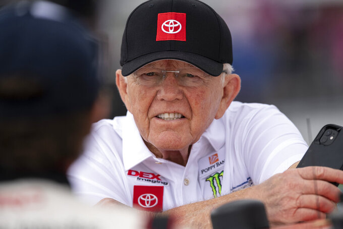 Owner Joe Gibbs has a conversation on pit road prior to the NASCAR Xfinity auto race at the Charlotte Motor Speedway Saturday, Oct. 9, 2021, in Concord, N.C. (AP Photo/Matt Kelley)