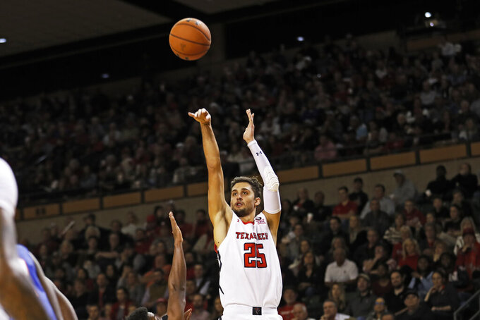 Texas Tech's Davide Moretti (25) shoots a 3-pointer during the second half of the team's NCAA college basketball game against Houston Baptist, Wednesday, Nov. 13, 2019, in Midland, Texas. [Brad Tollefson/Lubbock Avalanche-Journal via AP)