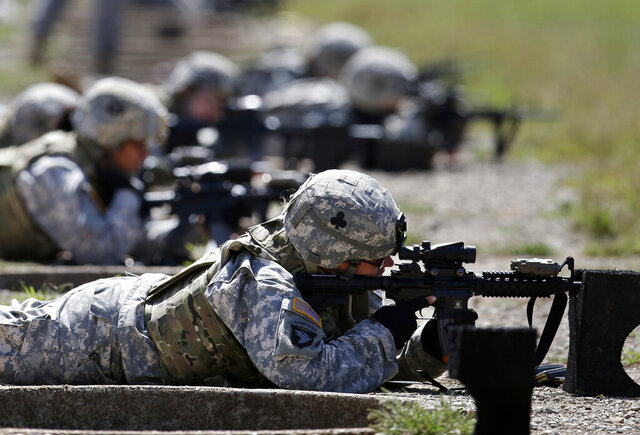"FILE - In this Sept. 18, 2012 file photo, female soldiers from 1st Brigade Combat Team, 101st Airborne Division train on a firing range while testing new body armor in Fort Campbell, Ky.  A federal appeals court in New Orleans upheld the constitutionality of the all-male military draft system Thursday, Aug. 13, 2020, citing a 1981 U.S. Supreme Court decision. The 5th U.S. Circuit Court of Appeals in New Orleans said ""only the Supreme Court may revise its precedent.""  (AP Photo/Mark Humphrey, File)"